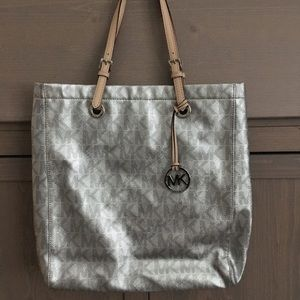 Michael Kors silver purse and wallet